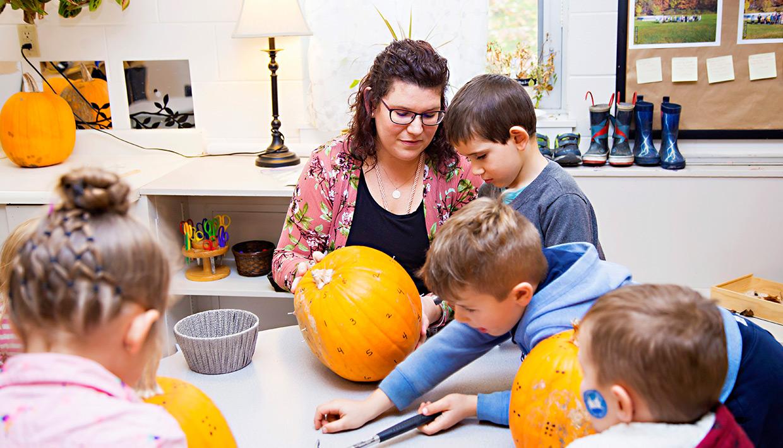 Holy-Name800-teacher-with-pumpkin